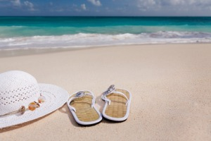 hat-and-flip-flops-on-the-beach